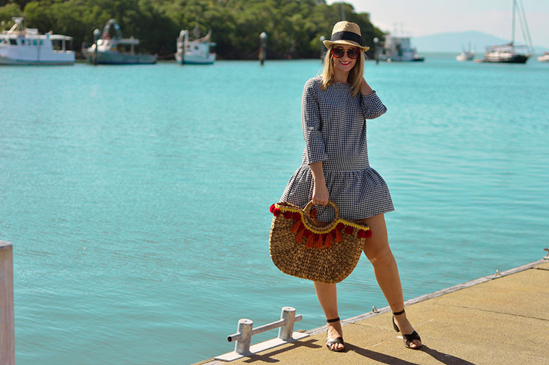 gingham dress outfit and wicker basket bag with pom poms summer style
