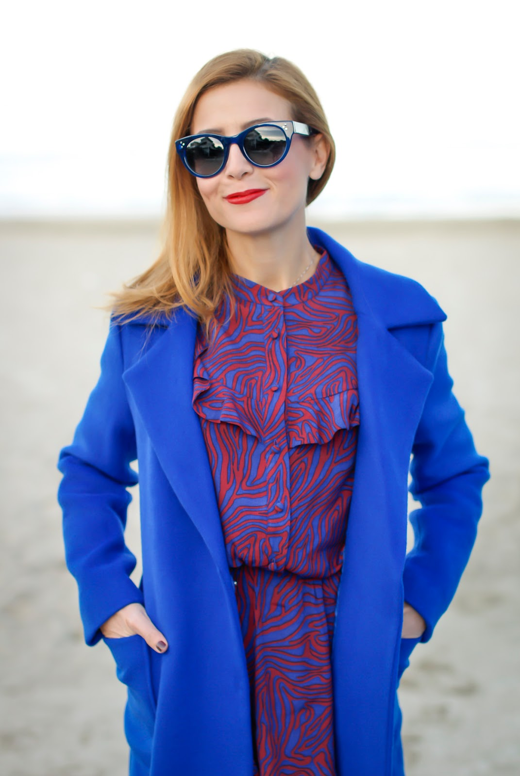 A long belted blue wrap coat from Dezzal worn with & Other Stories dress on Fashion and Cookies fashion blog, fashion blogger style