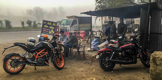 Our rides parked at Roadside dhaba while we warm ourselves with woodier and tea.