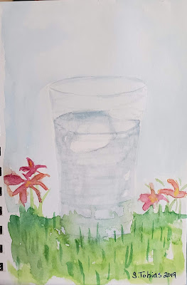watercolor of a glass of water sitting in grass with flowers by S. Tobias