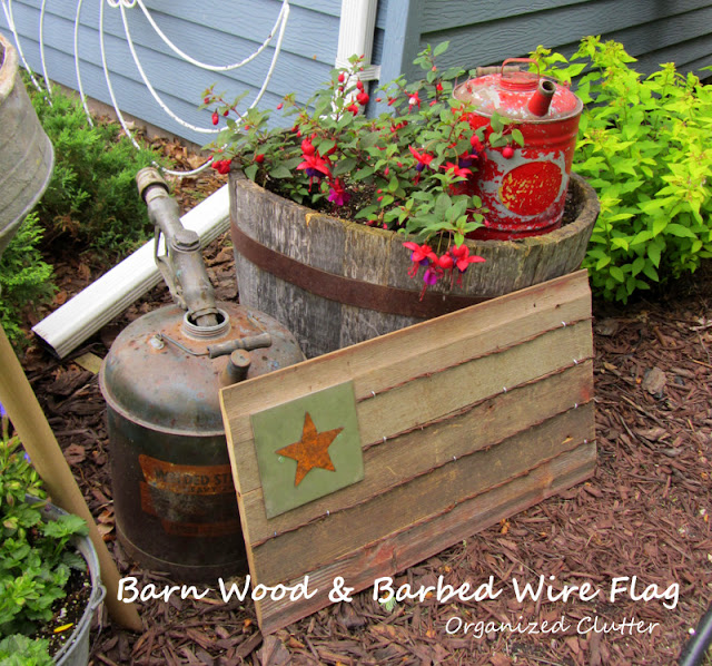 A Rustic Re-claimed Wood Flag In the Garden www.organizedclutterqueen.blogspot.com