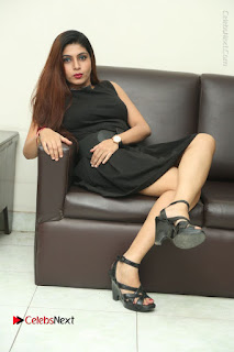 Tollywood Upcoming Actress Pooja Roshan Stills in Black Short Dress at Plus 1 Movie Trailer Launch  0326.JPG