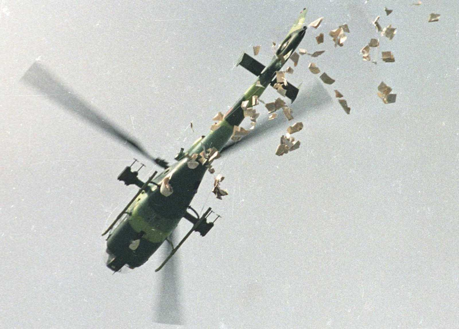 A military helicopter drops leaflets above Tiananmen Square which state that the student protesters should leave the Square as soon as possible, on May 22, 1989.