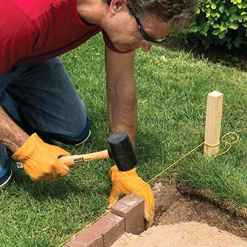 Un camino de adoquines sobre base de arena guia de jardin for Como hacer el jardin de mi casa