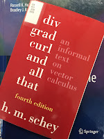 Div, Grad, Curl, and All That, by H. M. Schey, superimposed on Intermediate Physics for Medicine and Biology.