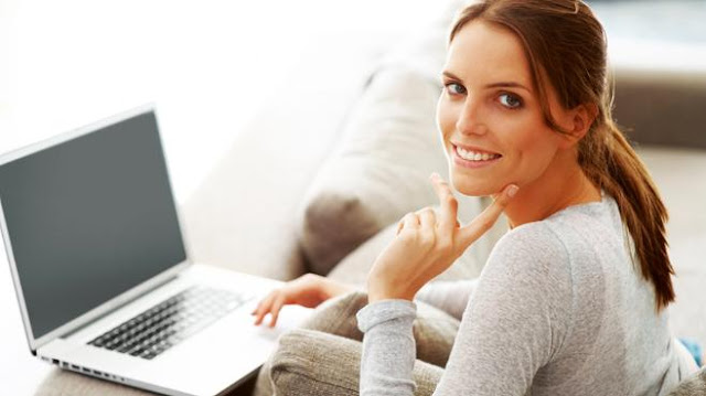hot chick: lovely girl smiling and using laptop