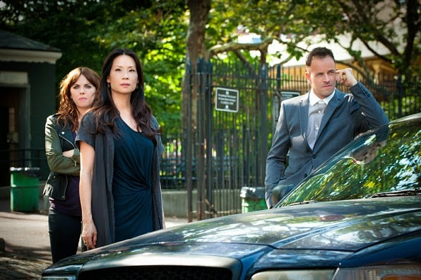Jonny Lee Miller Lucy Liu and Ophelia Lovibond as Sherlock Holmes Joan Watson and Kitty Winter in CBS Elementary Season 3 Episode 2 The Five Orange Pipz
