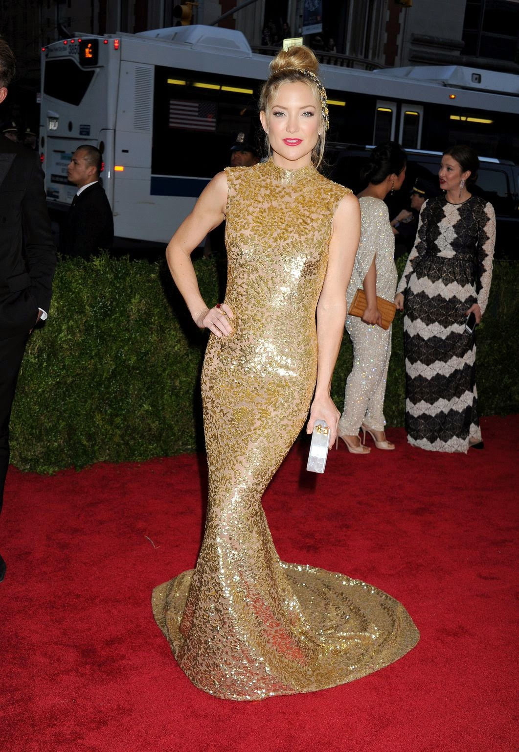 Kate Hudson dazzles in gold Michael Kors at the 2015 Met Gala in NYC