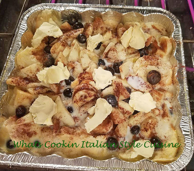 baked french toast with leftover panettone and fruits blueberry and apples for breakfast