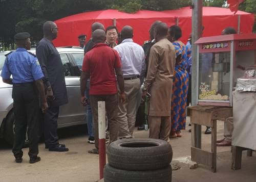 Photos: 'Boastful' Chinese diplomat attacked by angry mob after he refused to obey security procedures at Wuse market, Abuja
