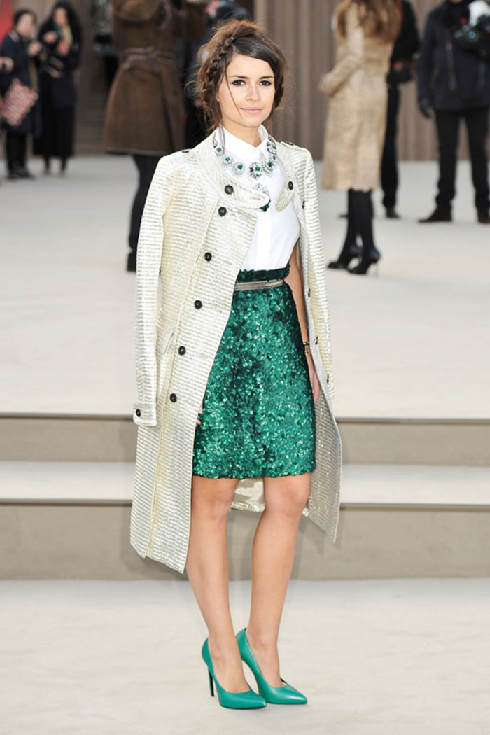 Miroslava Duma looks chic in a trench coat, sequin pencil skirt, statement necklace and matching pumps as a fashion icon