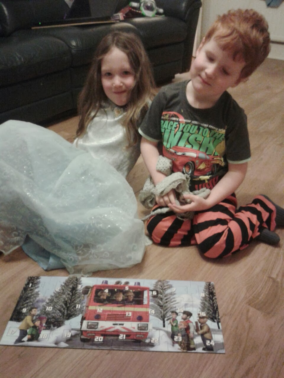 Caitlin and Ieuan with the completed Fireman Sam Advent Puzzle