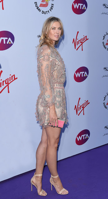 Maria Sharapova stunning leggy poses at WTA party carpet photo 4