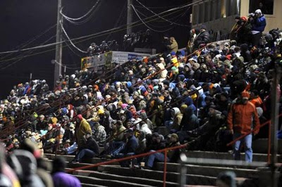 The crowd check out racing action Saturday night during the Snowflake 100 at Five Flags Speedway.