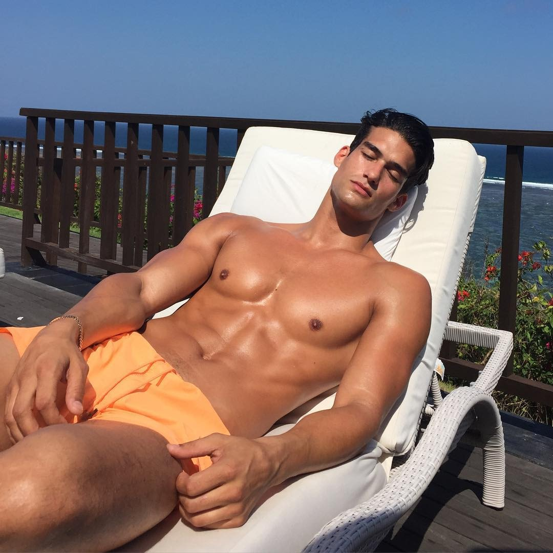 male-model-getting-tan-summer-sun