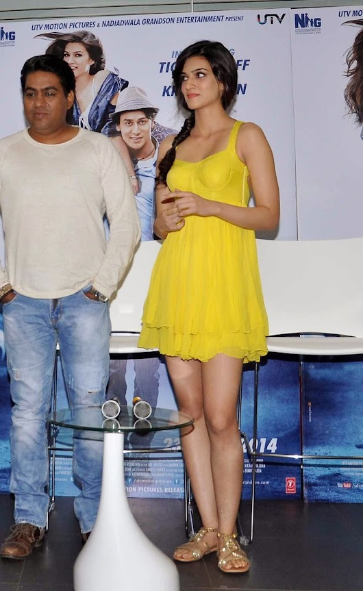 Kriti Sanon Showcasing Her Sexy Legs and Cleavage In Yellow Dress | Desifunblog