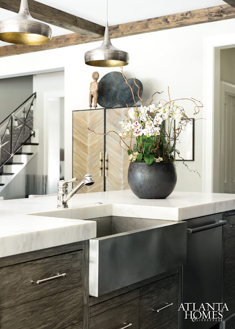 Modern eclectic kitchen with extra thick stone on island and farm sink