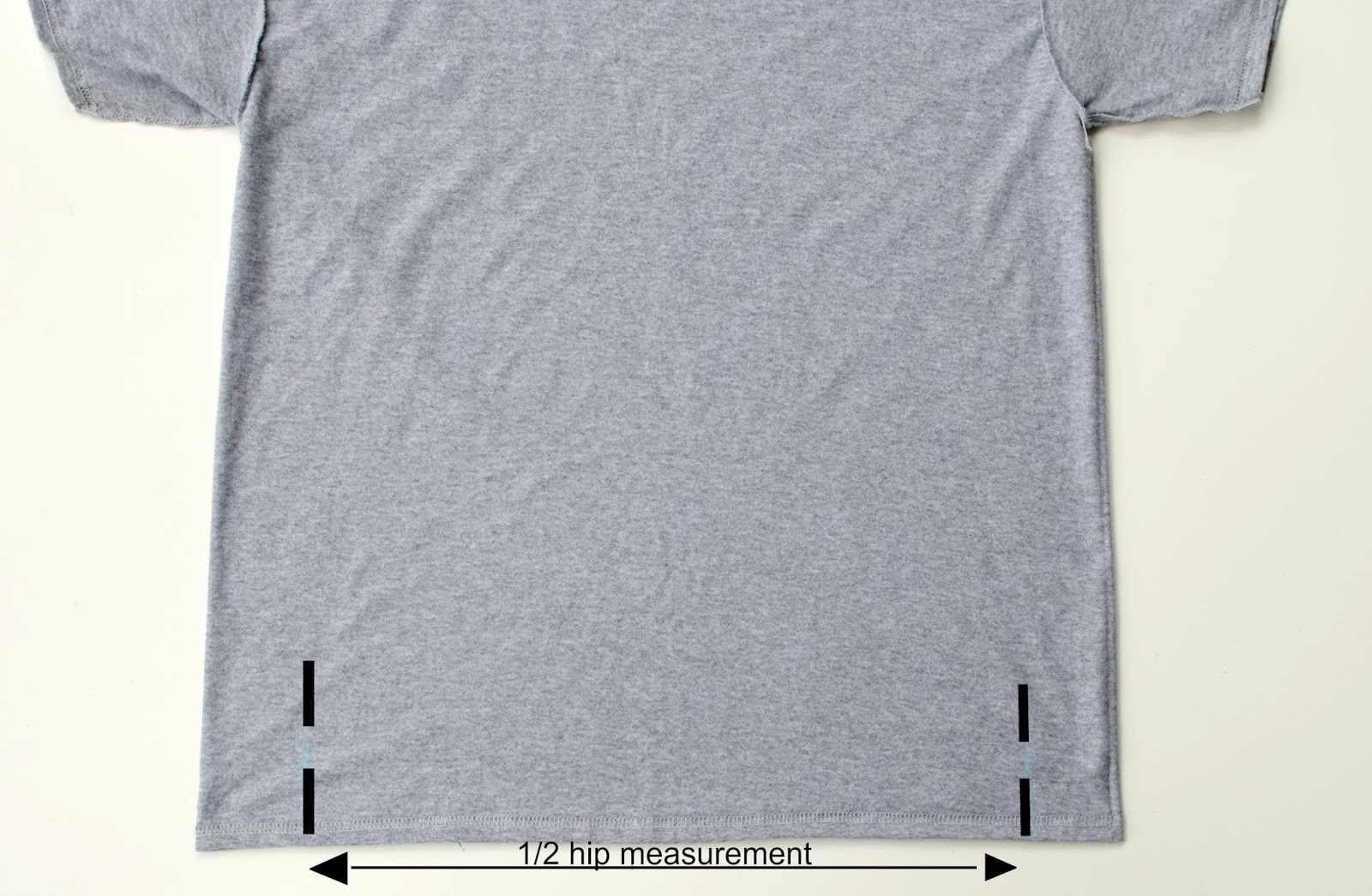 5c7b01b5d Mark your 1/2 your hip measurement inside the t-shirt so it's even.