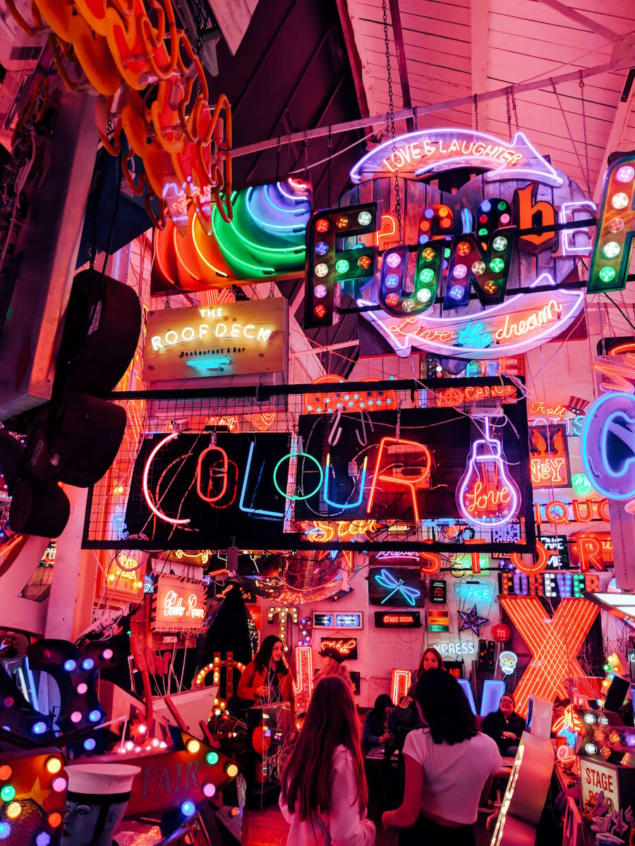 Neon lights adorn every corner of God's Own Junkyard