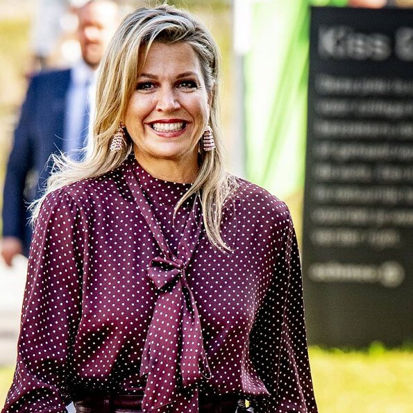 Queen Maxima wore Zara Polka dot blouse with bow detail, and burgundy ankle length wide leg high waisted leather trousers