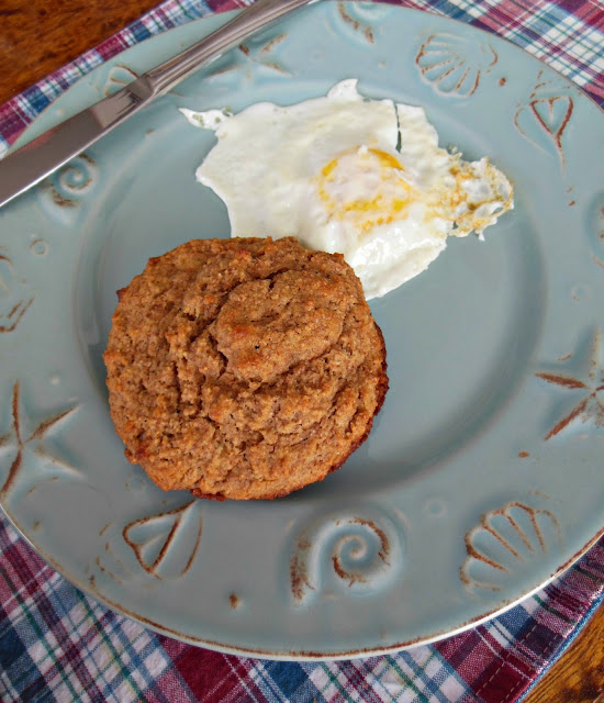 Whole grain banana crumb muffin top and a fried egg for breakfast.