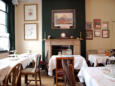 Soho's Secret Tearoom fireplace tables