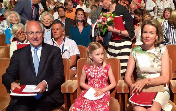 Queen Mathilde and Princess Eleonore of Belgium at Queen Elisabeth Piano Competition 2016 at Brussels Flagey in Brussels. Queen Mathilde wore Natan dress