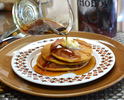 Pumpkin Pancakes ♥ AVeggieVenture.com. Light and fluffy, spiked with pumpkin spices. Another good reason to Make Tonight Pancake Night!