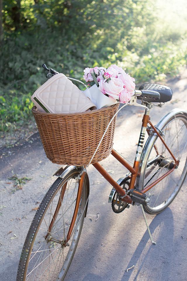 Vintage bike with pink flowers.