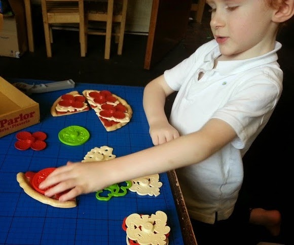Green Toys 100% recycled plastic toy Pizza Parlour Review boy making pizza
