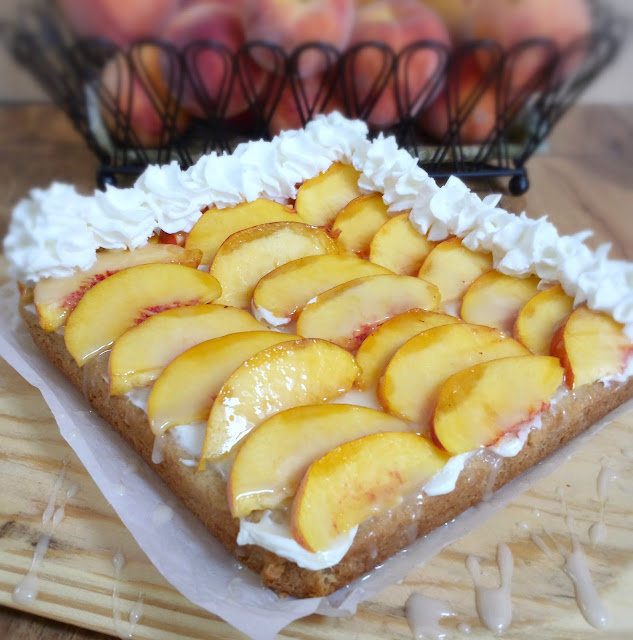 peach cheesecake bars with whipped cream rosettes