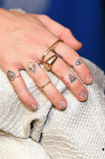 Miley Cyrus Fingers Tattoos