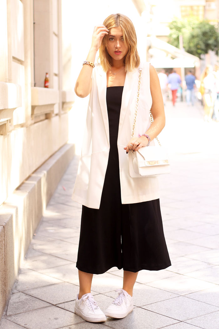 Black jumpsuit, white vest
