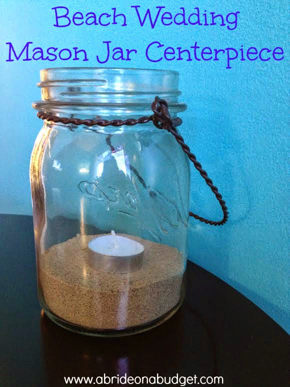 Are you planning your beach wedding but have NO IDEA what to do for centerpieces? Don't worry! These beach wedding mason jar centerpieces are the answer. Plus, they're PRETTY and EASY! Head to www.abrideonabudget.com for the tutorial.