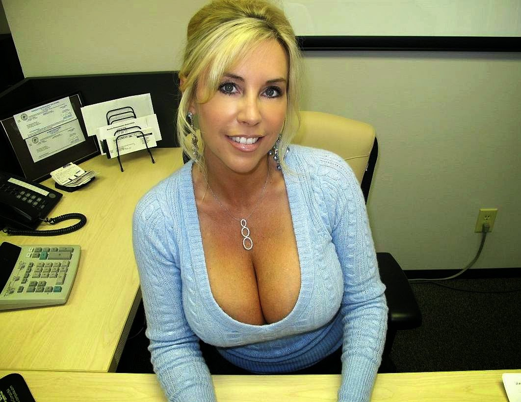 Cheating wife in low-cut blue blouse exposing big tits