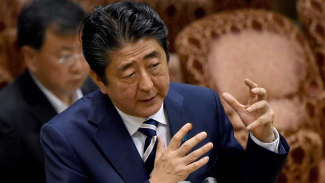 Japanese Prime Minister Shinzo Abe grilled in parliament amid falling popularity