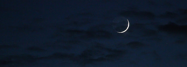 sliver of moon in night sky