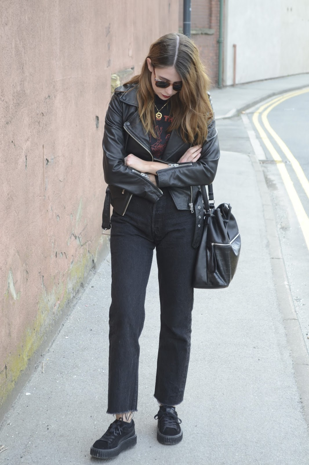 Black leather jacket Allsaints, Vintage black t-shirts, Black Levis 501, Puma x fenty by Rhianna.