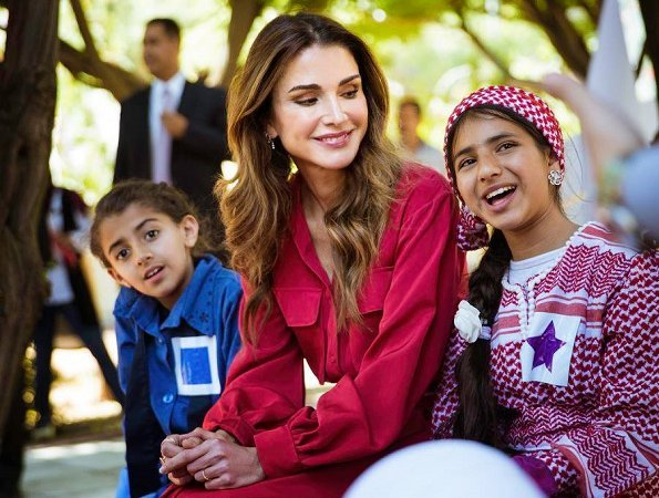 Queen Rania of Jordan visited Masahati Carnival organized by Madrasati initiative at Millennium Park in Amman. Queen wore red vintage belted shirt dress
