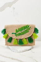 https://www.reddressboutique.com/collections/clutches/products/requesting-the-tropics-tan-clutch