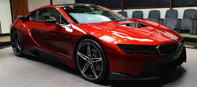 BMW i8 modified colored red lava. . I have a monster undisputed Abu Dhabi Motors