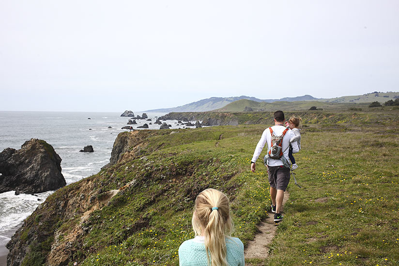 Family walks trail along Pacific Coast