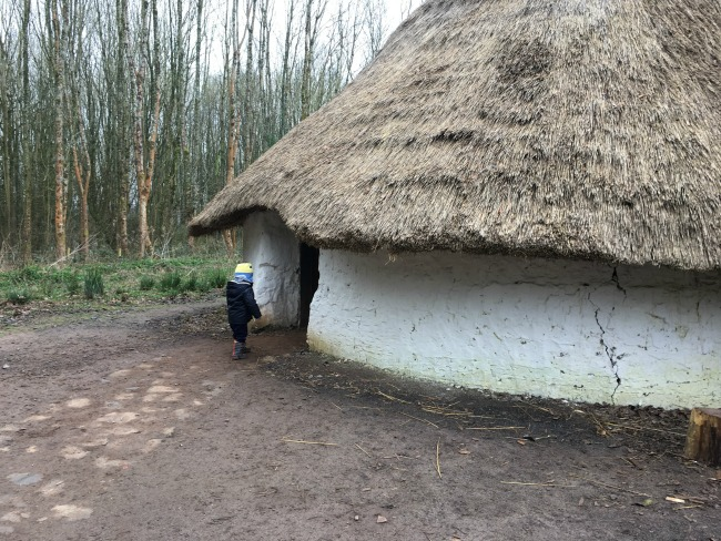 Our-Weekly-Journal-20-March-toddler-entering-a-roundhouse-at-saint-fagans-museum