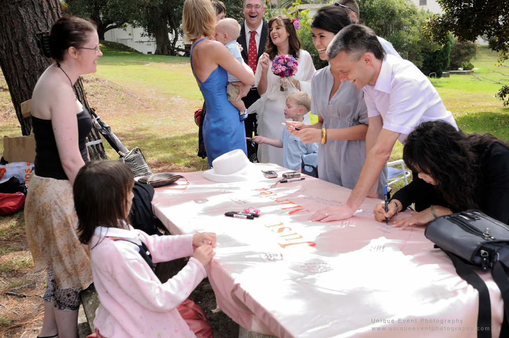 Guest sign the Swiss heart for the newly married couple. Garden Wedding in Vaucluse Sydney.