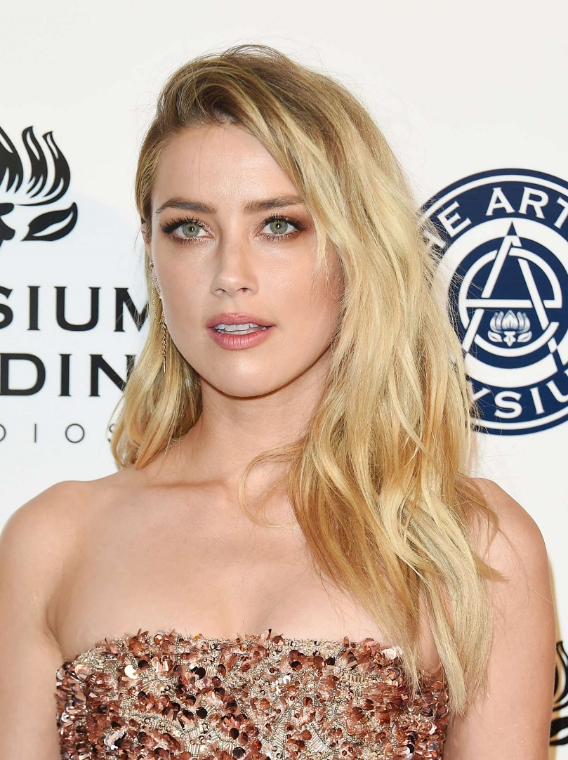 Amber Heard sparkles at the Art of Elysium gala