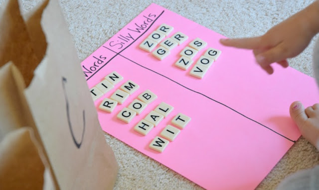 Grab and Sort: CVC Word Building. Fun phonics game for preschoolers or kindergartners using letter tiles to build and sort simple C-V-C words. Great for early readers.