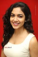 Actress Ritu Varma Stills in White Floral Short Dress at Kesava Movie Success Meet .COM 0221.JPG