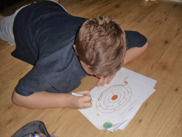 boy completing How To Catch A Star by Oliver Jeffers Book  activity sheets