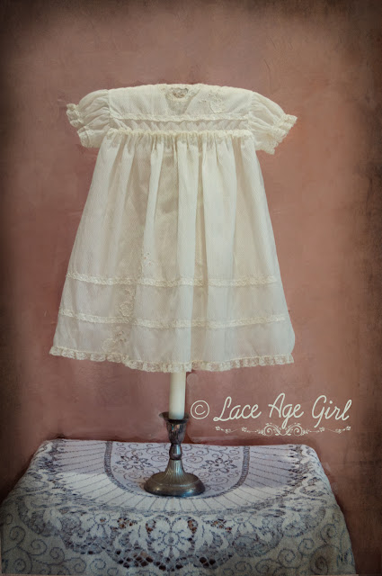 Repurposed candle holder baby dress display