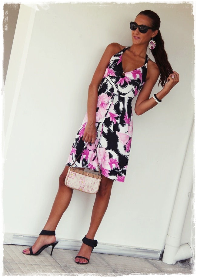 black and white halter open back dress with pink flowers